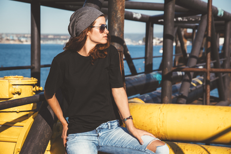 Foto de Model wearing plain black t-shirt and hipster sunglasses, teen urban clothing style, mockup for tshirt print store - Imagen libre de derechos