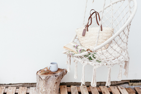 Photo for Summer hygge scene with hammock chair, book and flowers. Cozy place for weekend relax in the garden. - Royalty Free Image