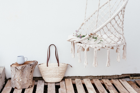 Photo pour Summer hygge scene with hammock chair, book and flowers. Cozy place for weekend relax in the garden. - image libre de droit
