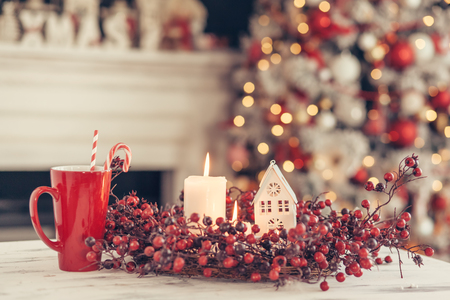 Photo pour Candles and Christmas decoration on table over blurred evening lights background - image libre de droit