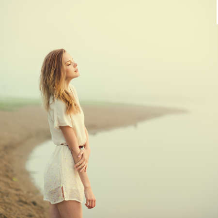 Photo for beautiful sad girl in the morning on the beach  - Royalty Free Image