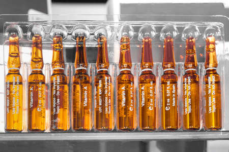 Foto de ampoules with vitamin A, on a gray background, used for cosmetic purposes - Imagen libre de derechos