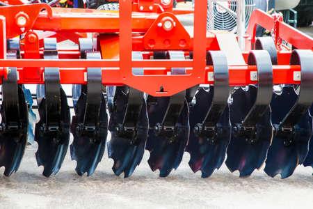 Photo pour New, black harrows for plowing fields, background photo - image libre de droit