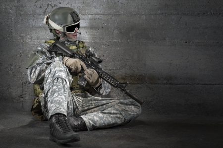 Soldier with rifle and mask resting