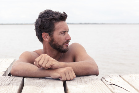 Photo for Close up Portrait of Confident Handsome Man with No Shirt Posing at the Sea - Royalty Free Image