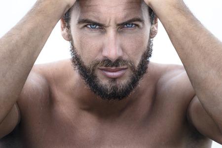 Foto de Close up Portrait of Confident Gorgeous Handsome Man looking at camera - Imagen libre de derechos