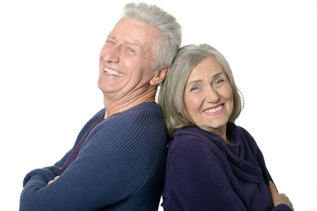 Happy smiling old couple on white background