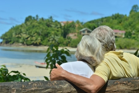 Photo for Happy elderly couple rest at tropical resort - Royalty Free Image