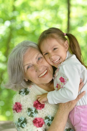 Foto de Grandmother with her granddaughter in summer  park - Imagen libre de derechos