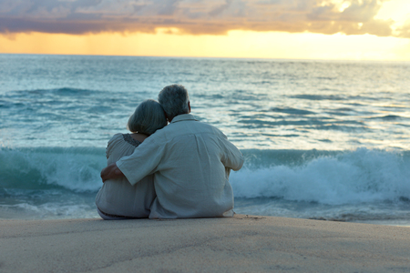 Photo for Beautiful happy elderly couple rest at tropical resort,back view - Royalty Free Image