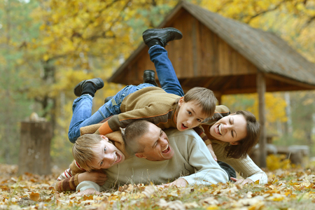 Portrait of beautiful family  in autumn forest