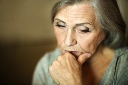 Photo pour Portrait of a thoughtful sad elderly woman - image libre de droit