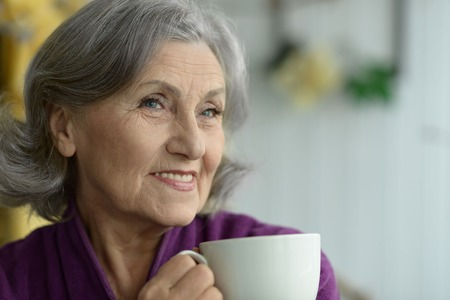 Photo for Attractive elderly woman with cup of coffee - Royalty Free Image