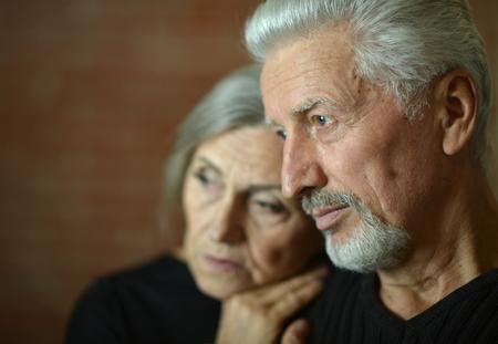 Photo pour sad Mature couple near wall in the room - image libre de droit