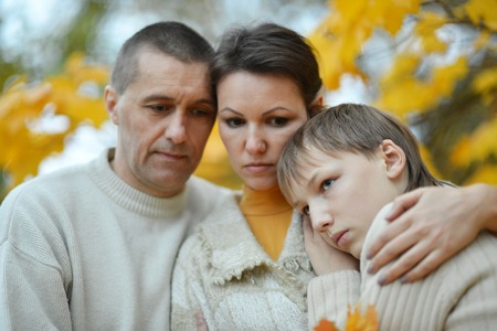 Foto de sad family of three on the nature - Imagen libre de derechos
