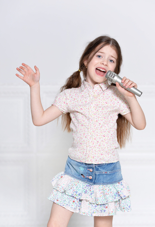 Photo for portrait of cute little girl  in beautiful dress singing - Royalty Free Image