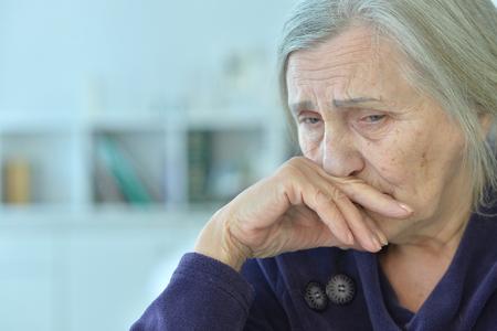 Foto de Beautiful sad elderly woman close-up - Imagen libre de derechos