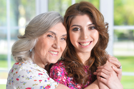 Photo for woman hugging daughter - Royalty Free Image