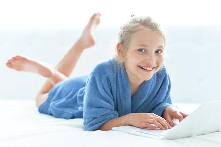 Photo pour Cute girl wearing blue bathrobe - image libre de droit