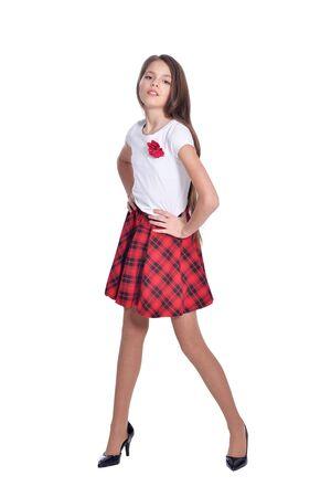 Foto de Happy little girl wearing high heels isolated on white background - Imagen libre de derechos
