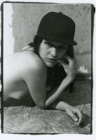 Photo pour Portrait of a beautiful girl with naked small breasts. Attention! Image contains grit and other artifacts of analog photography! - image libre de droit