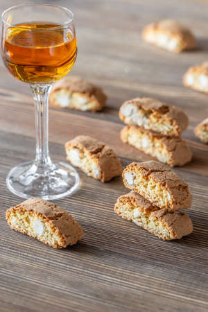 Photo for Cantuccini with a glass of Vin Santo - Italian dessert wine - Royalty Free Image