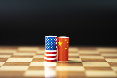 Photo pour USA flag and China flag on chess board for tariff trade war between United States and China who conflict because of both increase tax barrier of import and export product. Government and business. - image libre de droit