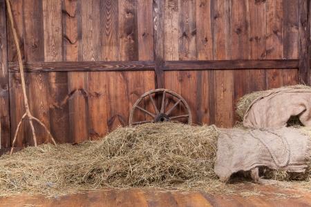 Foto de Wood and hay background inside rural barn - Imagen libre de derechos