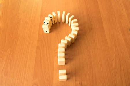 Photo for Question mark of dominoes knuckles on wooden background. - Royalty Free Image