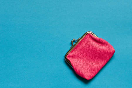 Photo for Pink wallet on blue background . Close up. Top view - Royalty Free Image
