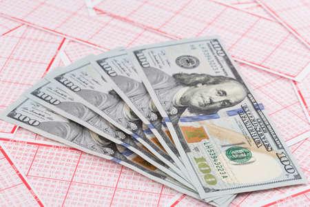 Foto de lottery ticket with dollar bank note close-up - Imagen libre de derechos