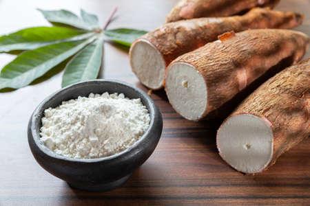 Photo pour Raw yucca starch on the wooden table - Manihot esculenta.. - image libre de droit