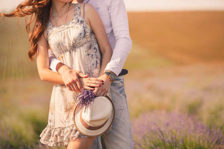 Foto de Young couple in love outdoor Stunning sensual outdoor portrait of young stylish fashion couple posing in summer in field - Imagen libre de derechos