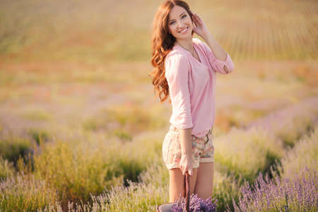 Beautiful girl on the lavender field  smiling beautiful brunette in the lavender field