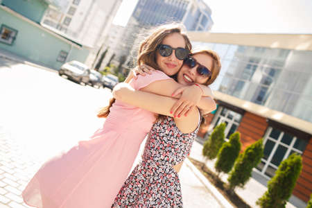 Photo pour two friends outdoors. two girls having fun. Smiling women outdoor. two beautiful young women having fun in the city. Two women friends laughing with a perfect white teeth - image libre de droit