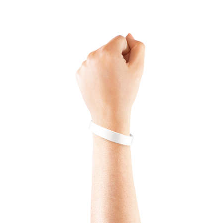 Foto de Blank white rubber wristband mockup on hand, isolated. - Imagen libre de derechos