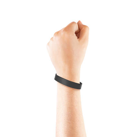 Foto de Blank black rubber wristband mockup on hand, isolated. Clear sweat band mock up design. Sport sweatband template wear on wrist arm.  Silicone fashion round social bracelet wear on hand. Unity band. - Imagen libre de derechos