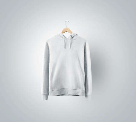 Foto de Blank white sweatchirt mockup hanging on wooden hanger. Empty sweat shirt mock up on rack isolated. Clear cotton hoody template. Plain textile hoodie design presentation. Loose overall casual jumper. - Imagen libre de derechos