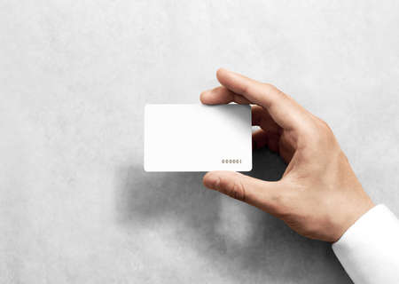 Photo pour Hand hold blank white loyalty card mockup with rounded corners. Plain vip mock up template holding arm. Plastic discount namecard display front. Gift offset card design. Loyal service branding. - image libre de droit