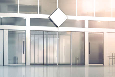 Foto de Blank white rhombus signage mockup on the store glass sliding doors entrance, 3d rendering. Commercial building automatic entry, banner mock up. Closed transparent business centre facade, front view. - Imagen libre de derechos