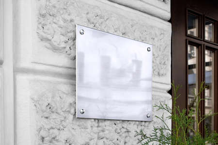Photo for Blank silver glass signboard on textured wall mockup - Royalty Free Image
