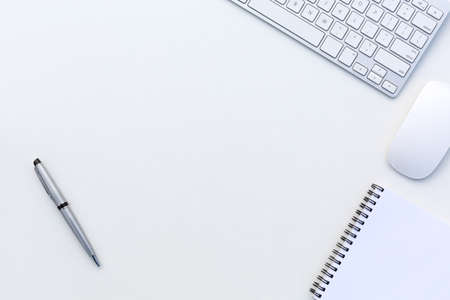 Foto de Creative Office Bright Table with Computer Keyboard Mouse Notepad and Executive Pen Top View with Copy Space - Imagen libre de derechos