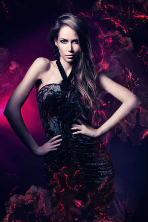 Photo pour sexy woman in black dress on dark magenta background - image libre de droit
