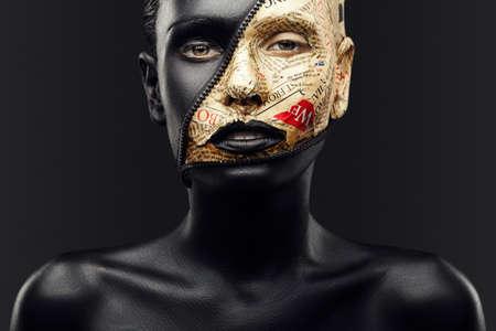 Foto de girl with black skin and make-up from the newspaper and lock zipper - Imagen libre de derechos