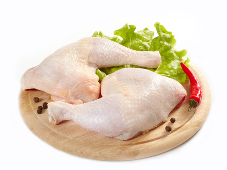 Photo for Raw chicken on a wooden cutting board with spices isolated on white - Royalty Free Image