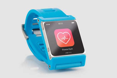 Foto de Close up blue smart watch with fitness app icon on the screen  - Imagen libre de derechos