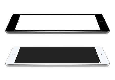 Foto de Black and white  tablet computers with blank screen mockup lie on the surface, left and right side view, isolated on white background. - Imagen libre de derechos