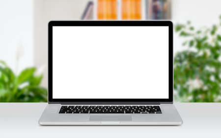 Photo pour Front view of modern laptop mockup with white blank screen on the office desk. Office space on the background. - image libre de droit