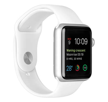 Foto per Varna, Bulgaria - October 16, 2015: Apple Watch Sport 42mm Silver Aluminum Case with White Sport Band with modular clock face on the display. Left side view fully in focus. Isolated on white background. - Immagine Royalty Free