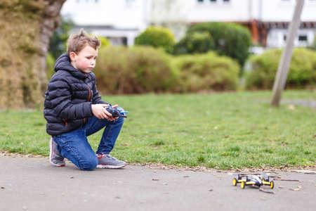 Foto de School boy with quadrocopter inthe park, London - Imagen libre de derechos